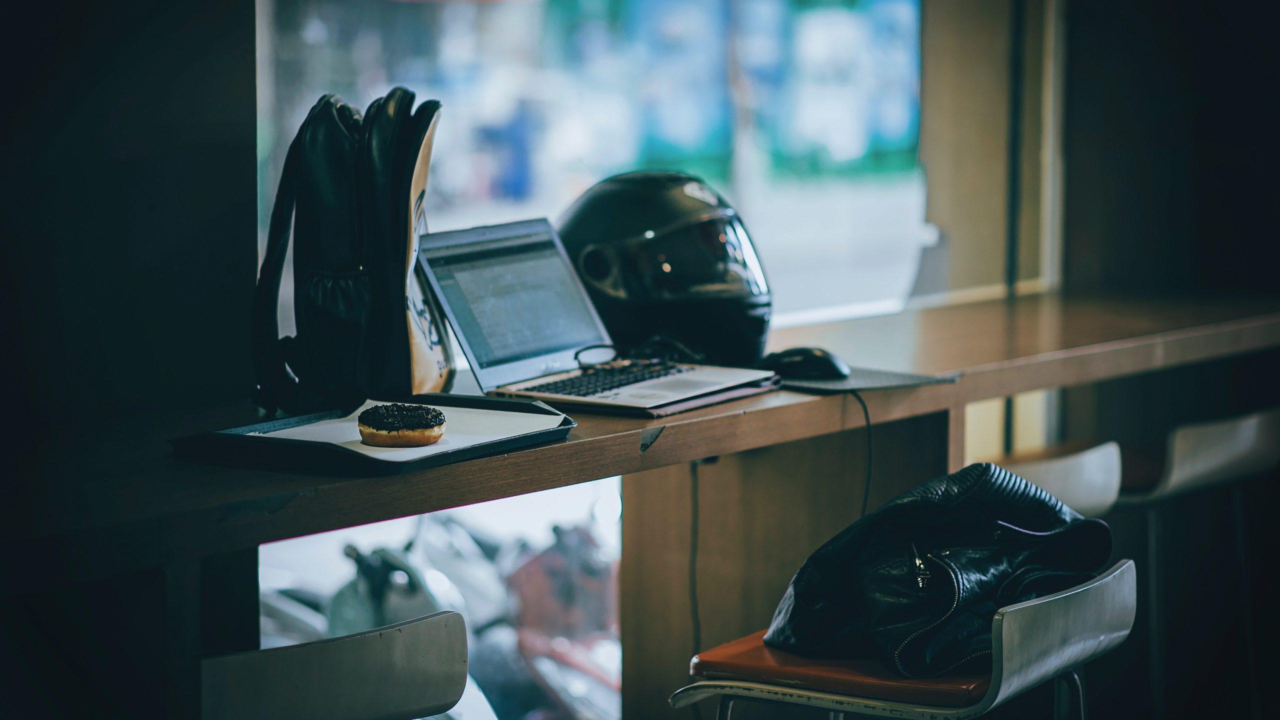 gray-laptop-near-black-full-face-helmet-681704